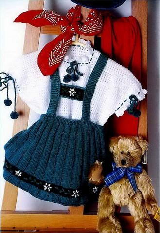 Вяжем юбку спицами для девочки на бретелях, фото
